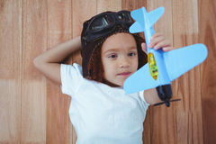 Smiling girl playing with toy airplane stock photography