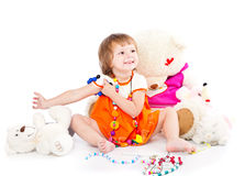 A smiling girl is playing with toys Stock Photos