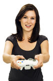 Smiling girl playing video game Stock Photos