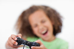 Smiling girl playing a video game Stock Images