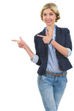 Smiling girl pointing on copy space Stock Photos