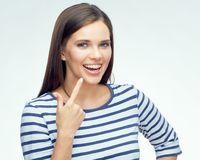 Smiling girl pointing finger on dental braces. White back isolated Royalty Free Stock Photos
