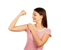 Smiling girl is pointing at her bicep. emotional girl isolated on white background Stock Photography