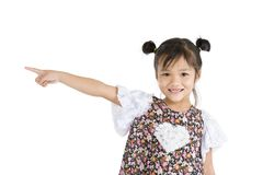 Smiling girl pointing to the side Stock Photography