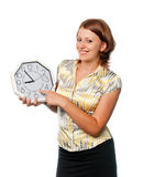 Smiling girl points a finger at clock Stock Photo