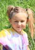 Smiling girl with ponytails Royalty Free Stock Photography