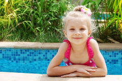 Smiling girl in the pool Royalty Free Stock Photo