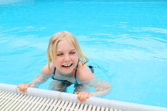 Smiling girl in pool Royalty Free Stock Photography