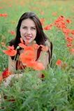 Smiling girl with poppies Royalty Free Stock Image