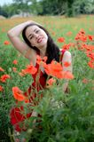Smiling girl with poppies Royalty Free Stock Photography