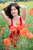 Smiling girl with poppies Royalty Free Stock Photos