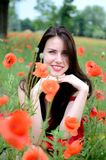 Smiling girl with poppies Stock Photo