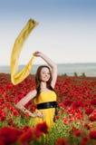 Smiling girl in the poppy field Stock Photo