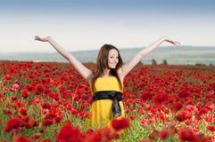 Smiling girl in the poppy field Stock Image
