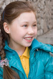 Smiling girl portrait. Smiling brown-haired girl with braid royalty free stock photo