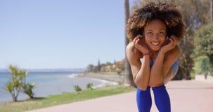 Smiling girl posing on beach Royalty Free Stock Photos