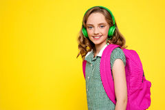 Smiling girl posing with headphones Royalty Free Stock Photos