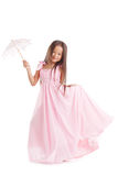 Smiling girl posing in long dress with umbrella Royalty Free Stock Images