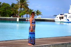 Happy girl. Smiling girl posing outdoors in maldives royalty free stock image