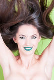Smiling girl posing skin hair and beauty make-up concept Stock Image