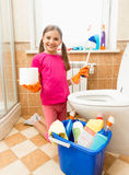 Smiling girl posing with toilet paper and brush at bathroom Stock Photography