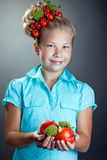 Smiling girl posing with wreath of cherry tomatoes Stock Photography