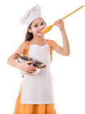 Smiling girl with pot and ladle Royalty Free Stock Photography