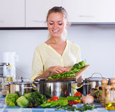 Smiling girl preparing healthy lunch at home Royalty Free Stock Photo