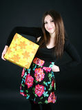 Smiling girl with present box Royalty Free Stock Images
