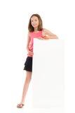 Smiling girl presenting blank banner Stock Image