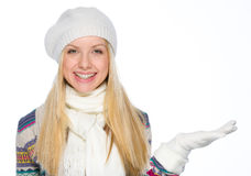 Smiling girl presenting something on empty hand Stock Photos