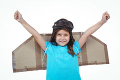 Smiling girl pretending to be pilot. Smiling girl with outstretched arms pretending to be pilot on white screen Stock Photo