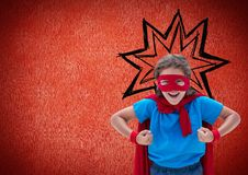Smiling girl pretending to be a superhero against red background Royalty Free Stock Photo