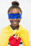 Smiling girl pretending to be a superhero. Portrait of smiling girl pretending to be a superhero Royalty Free Stock Images