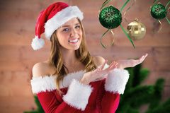 Smiling girl pretending to hold a imaginary christmas decoration Stock Photo