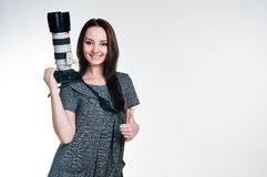 Smiling girl with professional camera Royalty Free Stock Photo