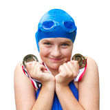 Smiling girl proud of swimming medals Royalty Free Stock Photography