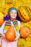 Smiling girl with pumpkin Royalty Free Stock Image