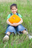 Smiling girl with pumpkin Stock Photography