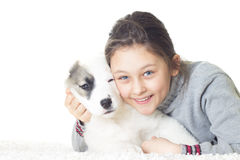 Smiling girl and puppy Stock Photography