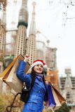 Smiling girl with purchases in Barcelona Stock Image