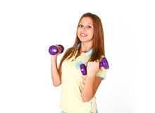 Smiling girl with purple dumbbells in shorts Stock Photo