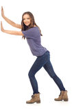 Smiling girl pushing Stock Photos