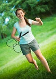 Smiling girl with a racket for a badminton in the  Stock Photography