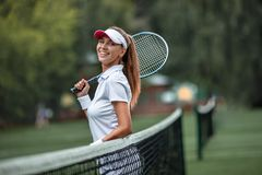 Smiling girl with a racket royalty free stock photos