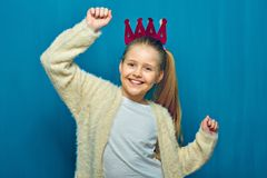 Smiling girl with raising hand up. Portrait on blue stock images