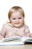 Smiling girl reading book Stock Image