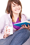 Smiling girl reading a book Stock Image