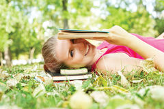 Smiling Girl Reading Book Royalty Free Stock Photo