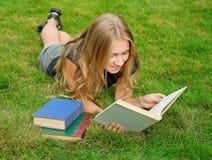 Smiling girl reading book Stock Photo